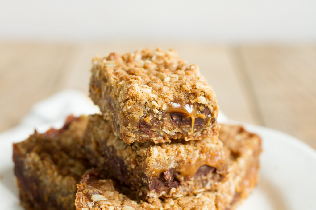 Carmelitas have a buttery oatmeal cookie base and topping, and a luscious chocolate and caramel filling.