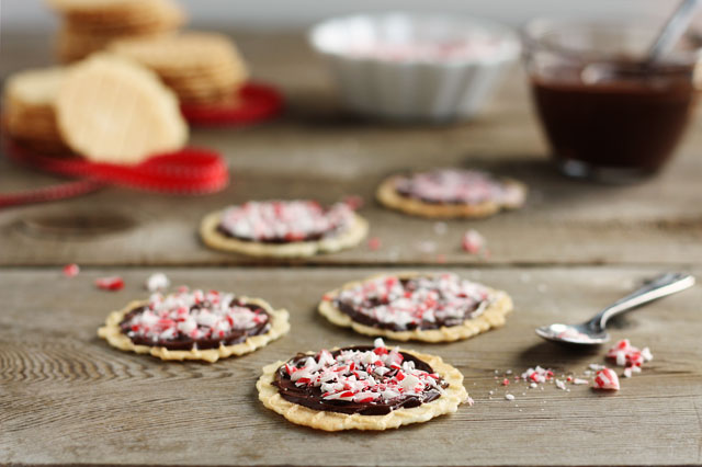 These buttery, wafer-tin waffle cookies are topped with rich chocolate and crushed peppermint!