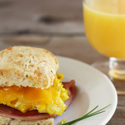 These ham, egg, and cheese breakfast sandwiches on cheddar chive biscuits are just as delicious for dinner as they are for breakfast!