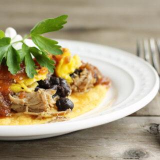 huevos rancheros with sweet pork and black beans