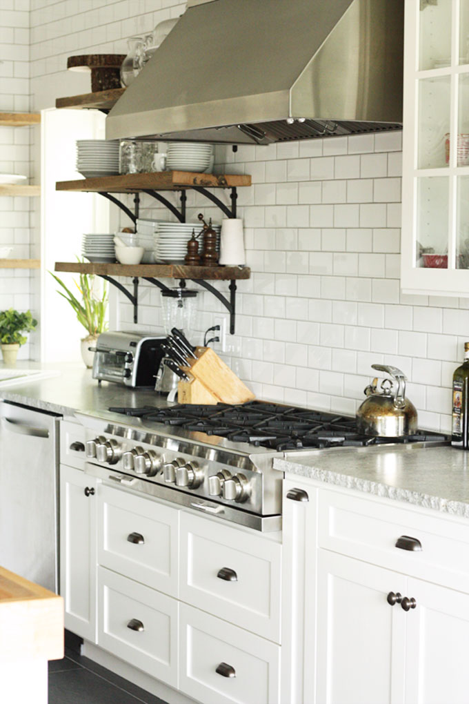 white kitchen with subway tile and open shelves