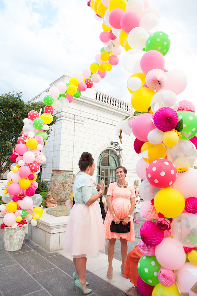 giant balloon arch with flowers and honeycomb balls