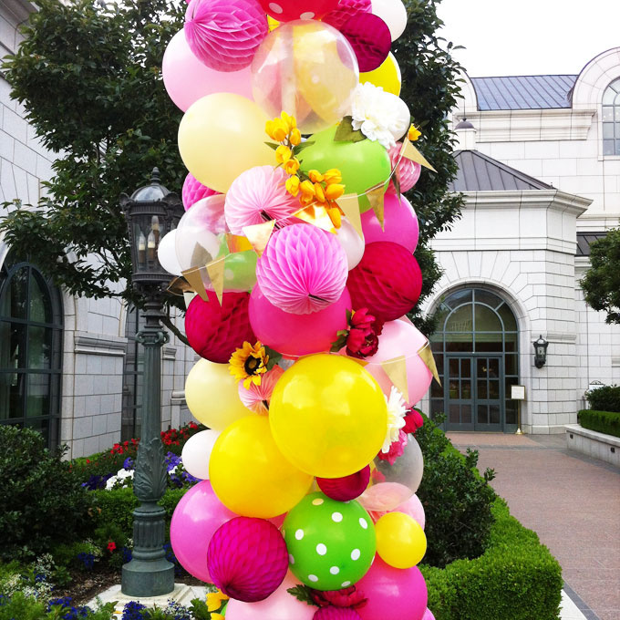 balloon arch with honeycomb balls and flowers