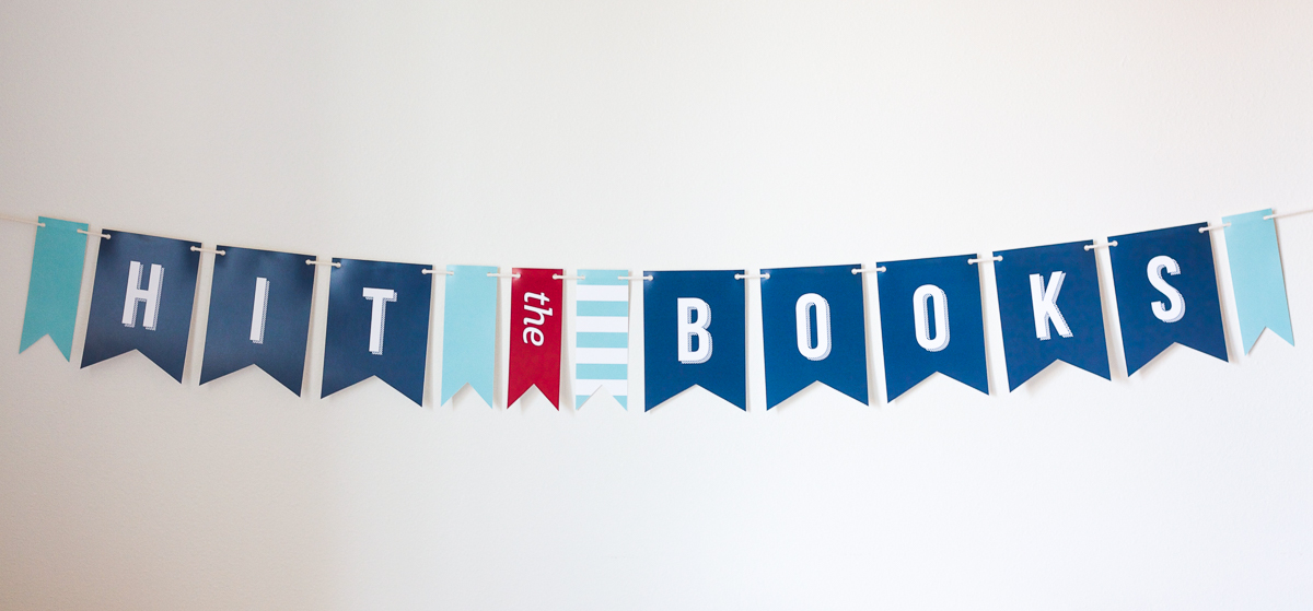 "Make this fun ""Hit the Books"" banner out of card stock and twine, and include it in a back-to-school care package for your favorite little students."