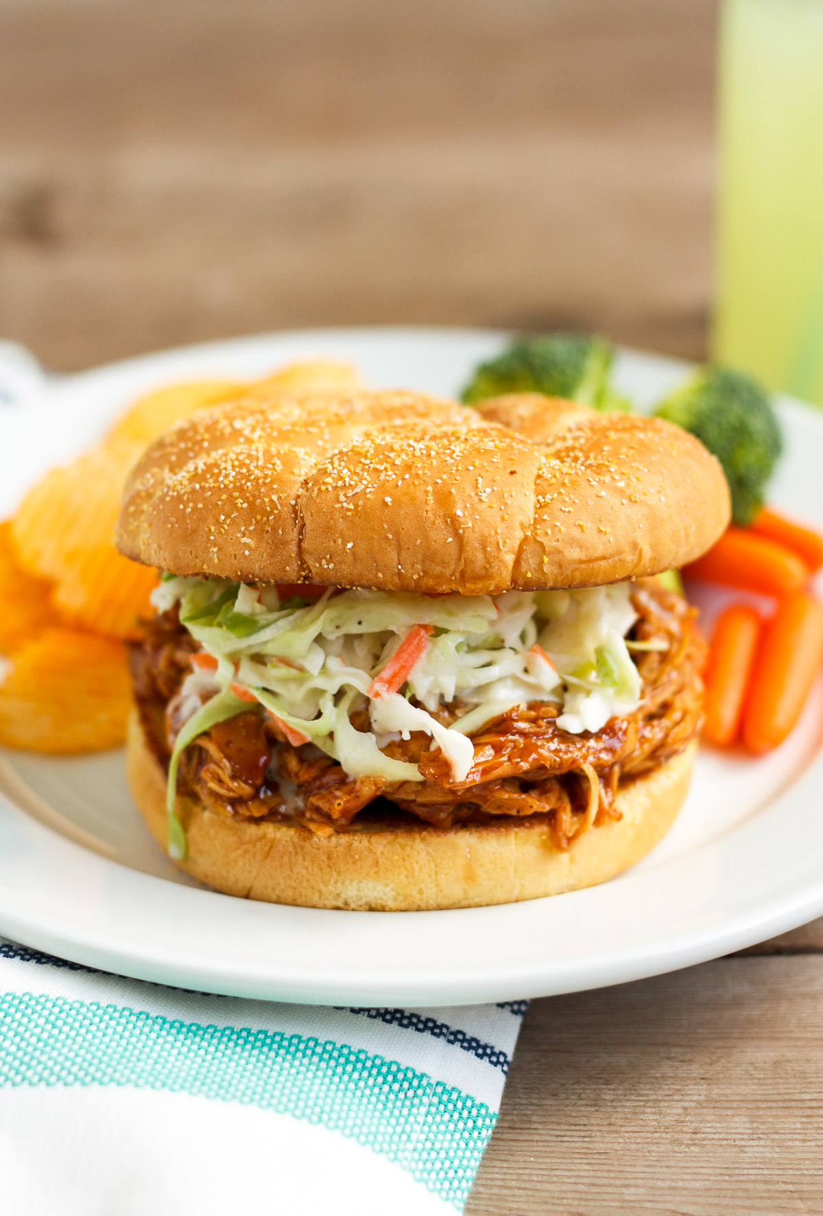 These barbecue chicken sandwiches are served on a buttered, griddled bun, and topped with creamy, homemade cole slaw. You'll want to eat them every week!