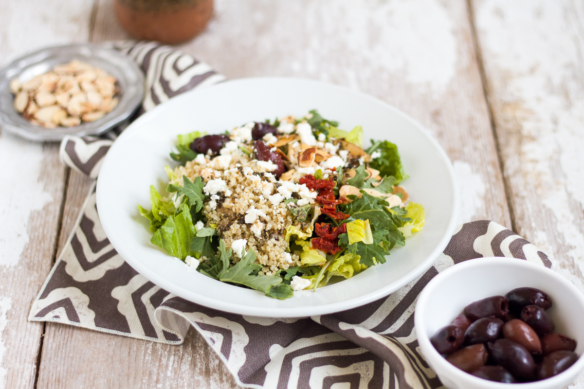 This Mediterranean Salad with Kale & Quinoa tastes just like the one served at Panera Bread. It's easy to make at home and is full of good-for-you ingredients like kale, quinoa, and almonds.