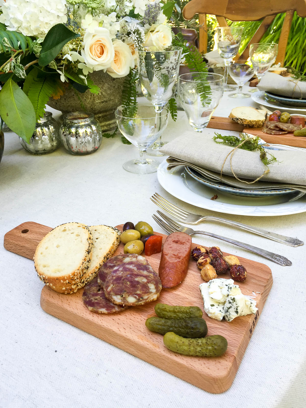 Use small cutting boards to create mini charcuterie boards or cheese plates for a casual-chic gathering.
