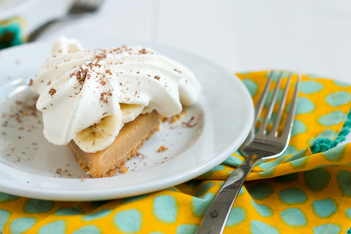 Banoffee Pie starts with a buttery, graham cracker crust filled with an easy-to-make, sticky stove top caramel. Add some banana slices and a pile of whipped cream, and you've got yourself one amazing dessert!