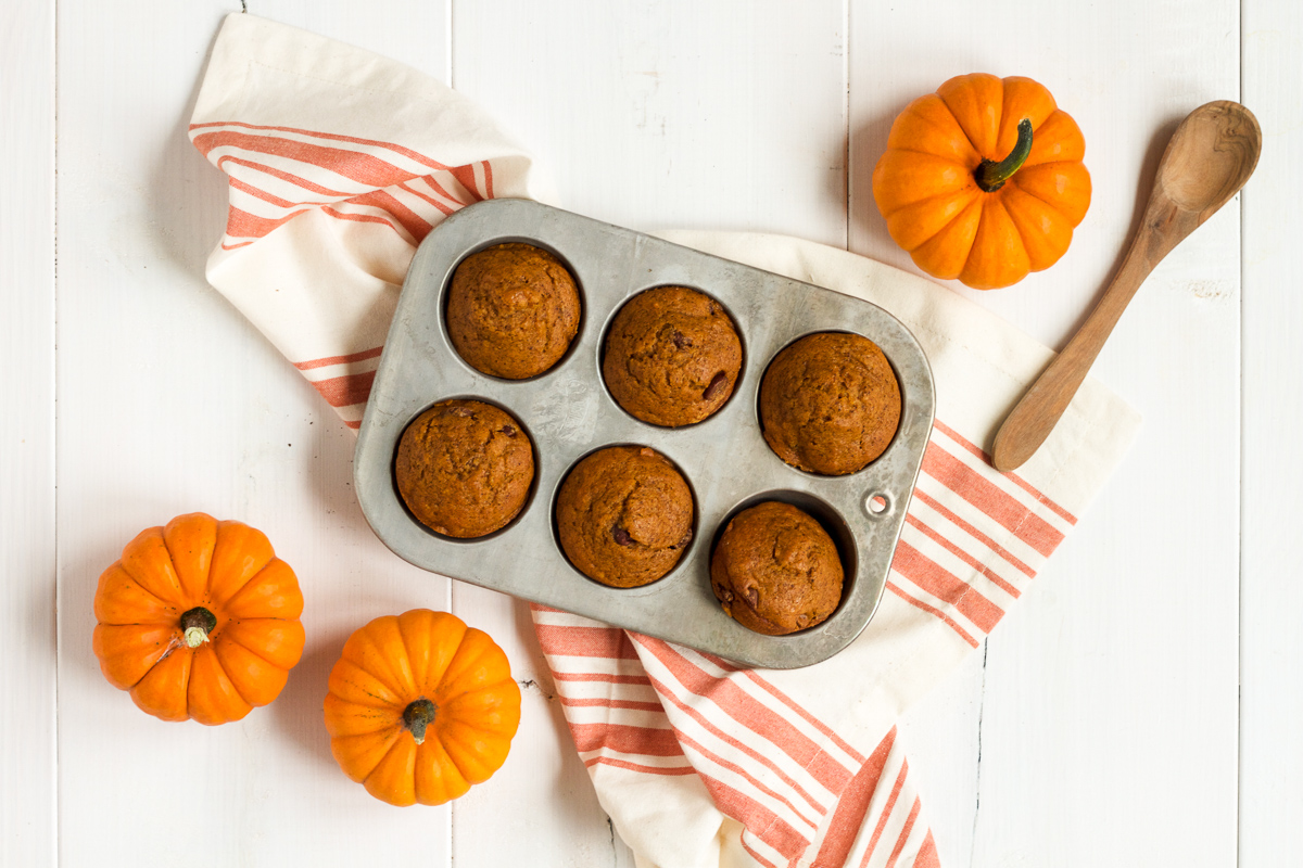 Bake up a batch of these delicious pumpkin chocolate chip muffins today!