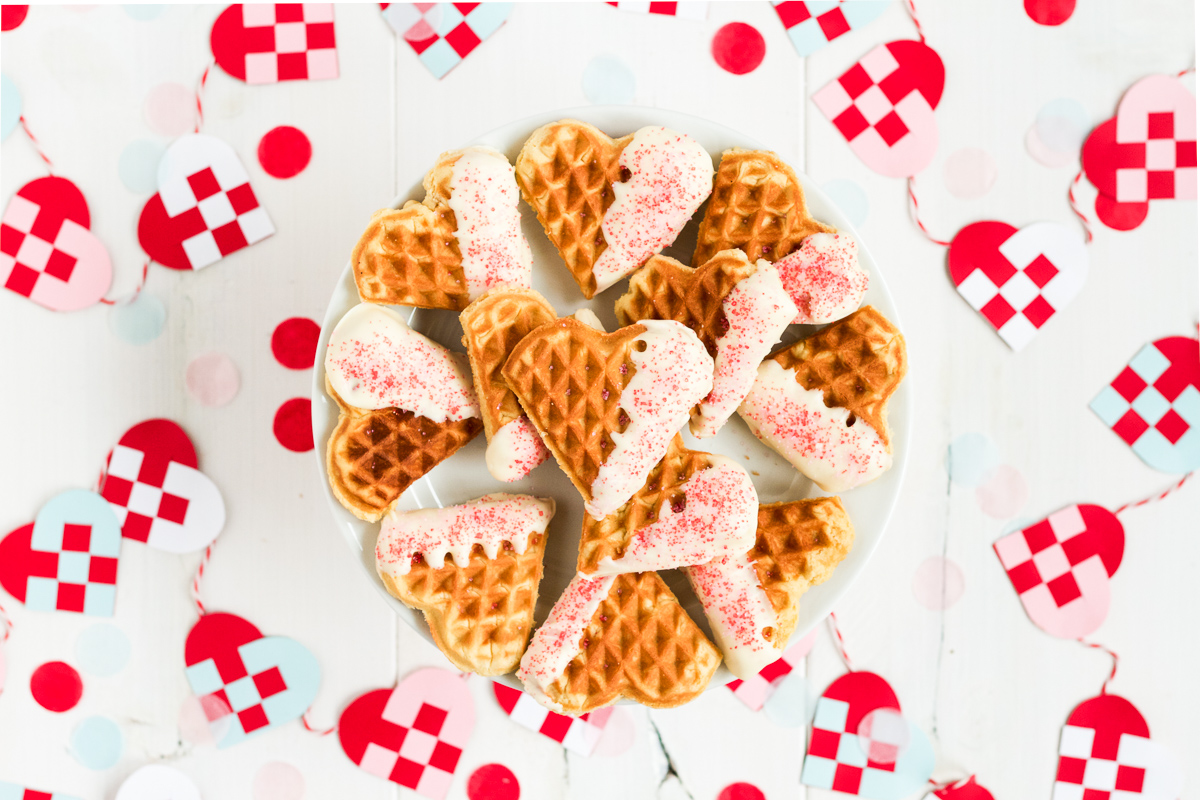 Heart-shaped waffle cookies dipped in white chocolate
