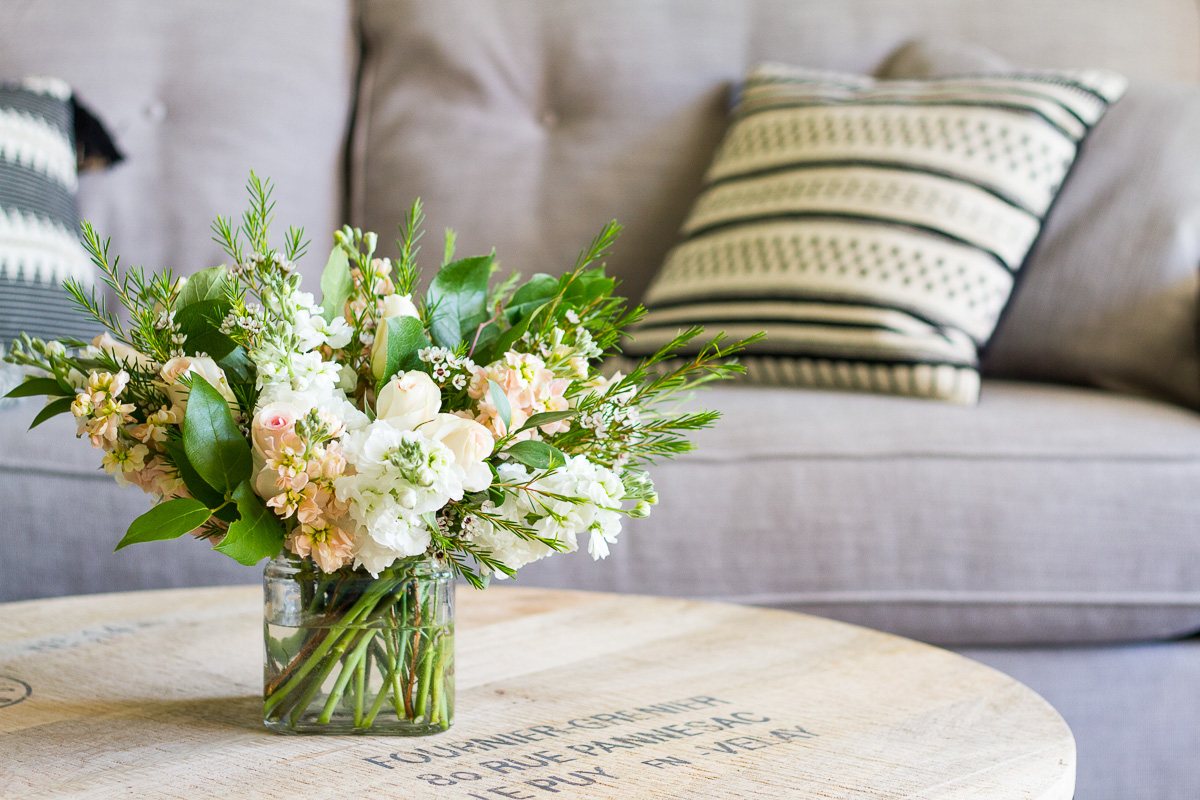 White and peach flowers for a naturalist living room makeover.
