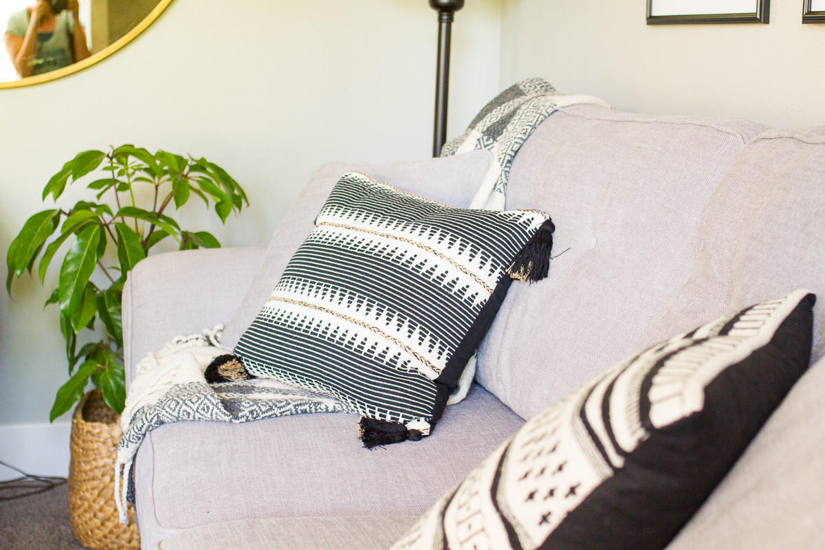 gray couch with black and white pillows