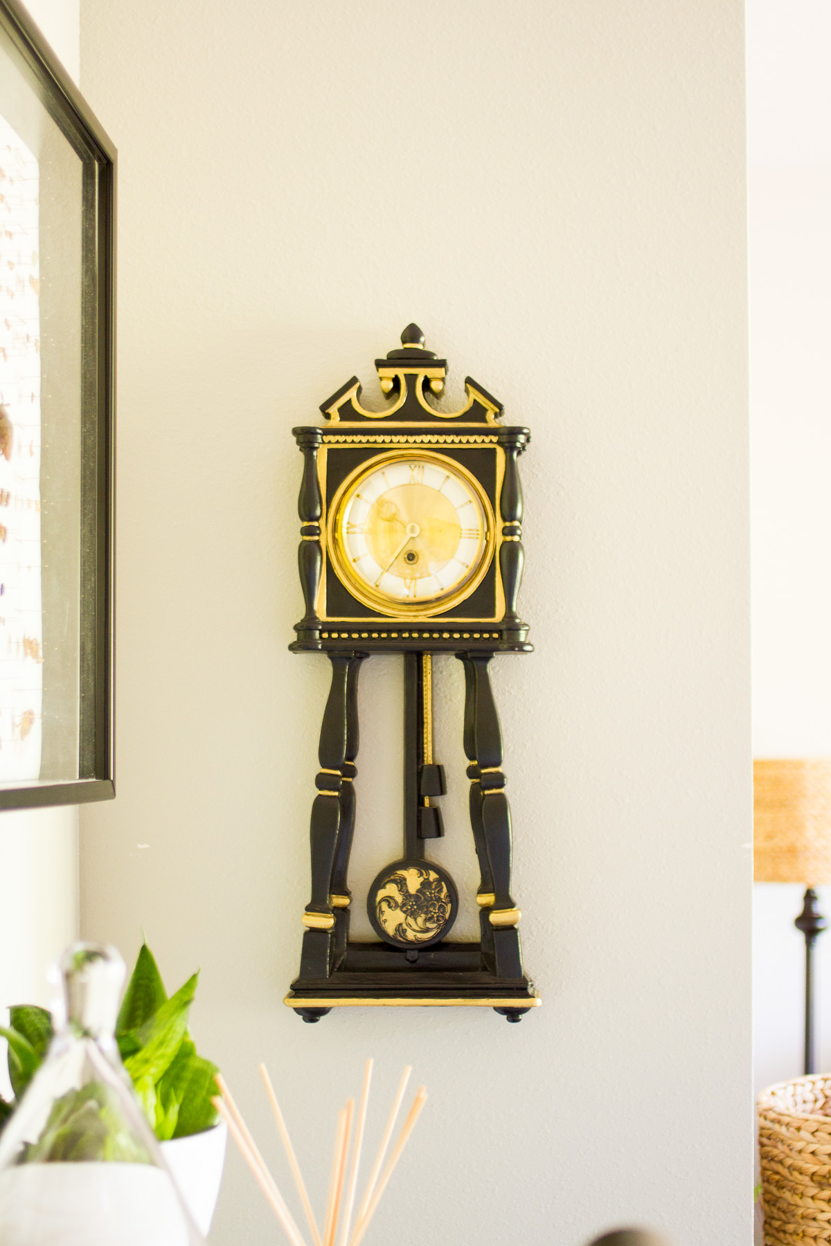 handpainted black and gold plaster clock