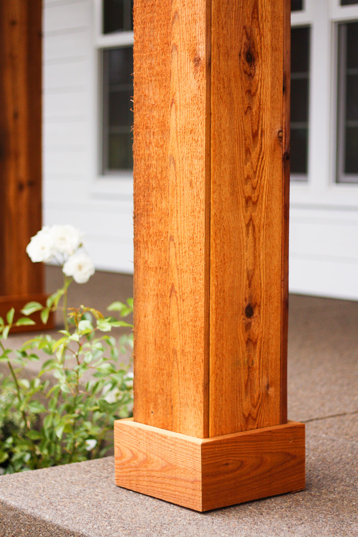 We turned the plain white front porch pillars into cedar pillars, and our porch has never looked better.