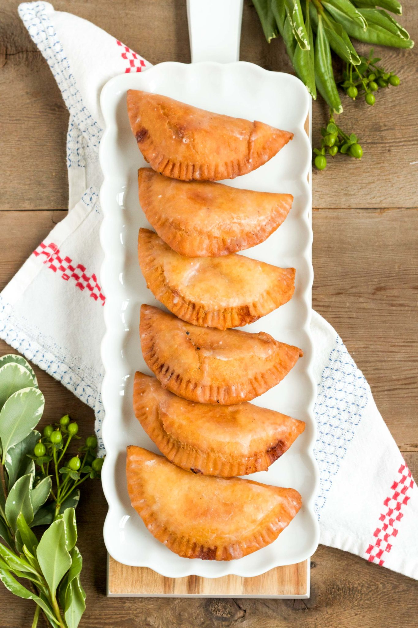 These delicious fried hand pies are filled with homemade peach jam, and are topped with a sweet, sugary glaze!