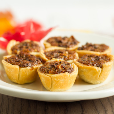 These mini chocolate pecan pies are delicious and easy to make. They're a perfect addition to your Thanksgiving or Friendsgiving dessert table!