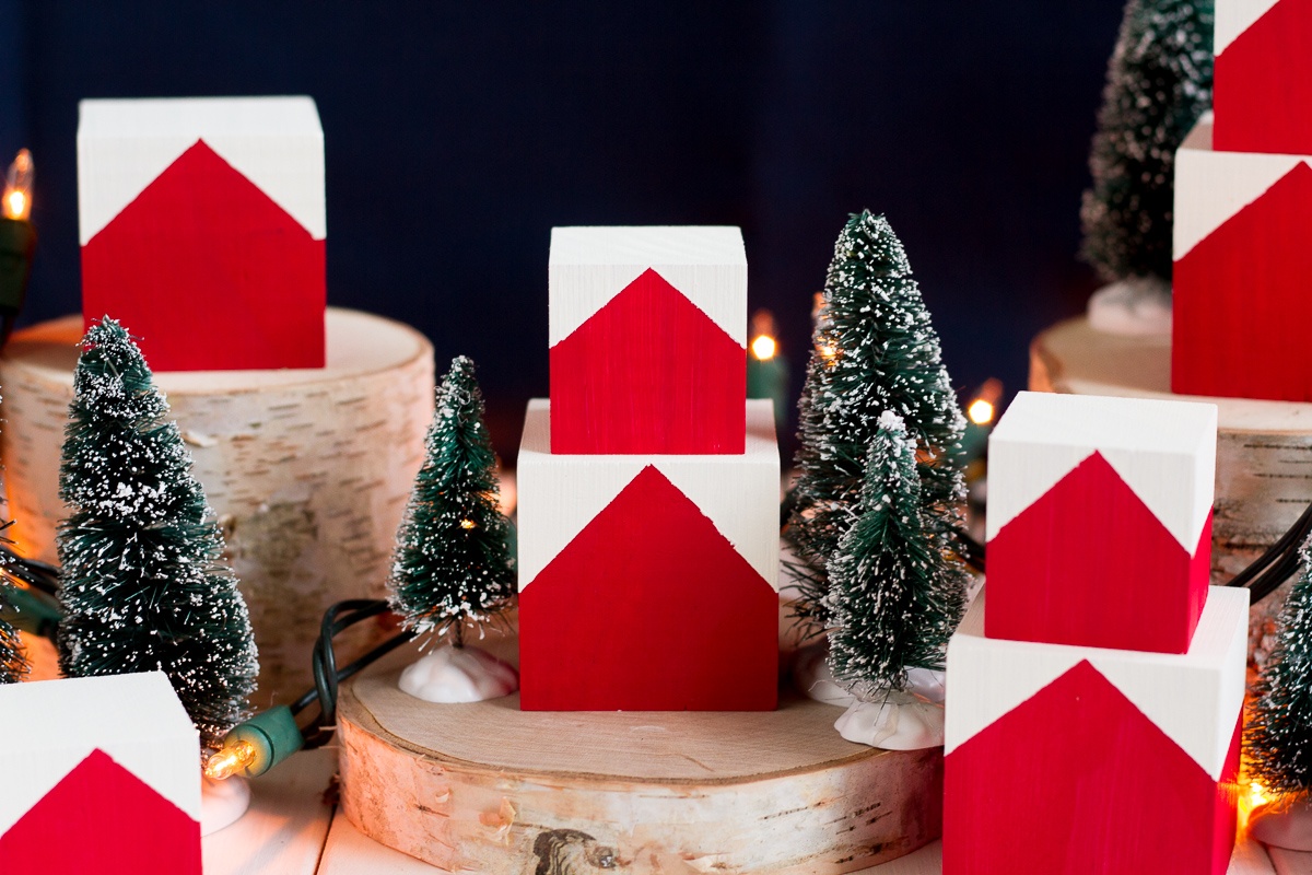 These cute and easy DIY Norwegian Christmas House blocks are inspired by the red and white houses tucked into the hillsides of fjord country.
