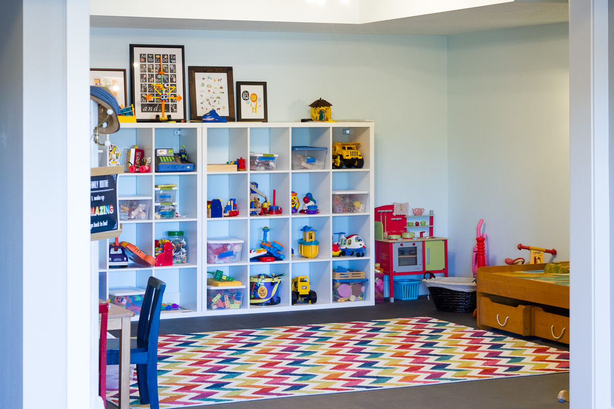 We cleaned and reorganized our playroom over the holidays, thanks to the Dymo Letratag label maker. Two weeks in and the room is still spotless!