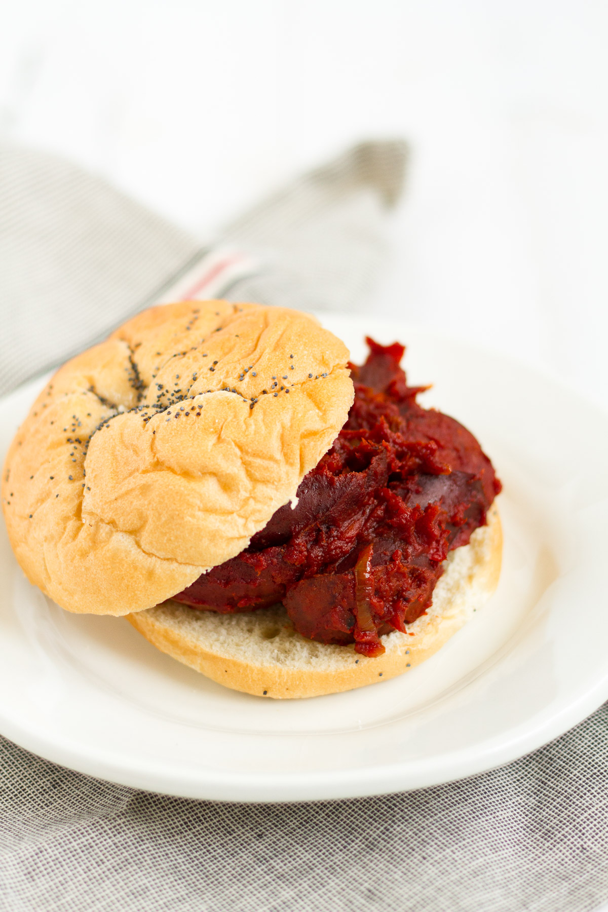 Tomato-braised sausage sandwiches with onions and peppers