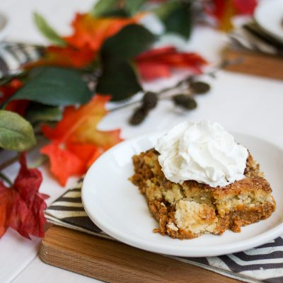 Pumpkin pie cake is a long-time family favorite from both my mom and my mother-in-law. A layer of pumpkin custard is topped with a crumbly cake layer, melted butter, crunchy pecans, and a sprinkle of cinnamon. The perfect dessert for fall!