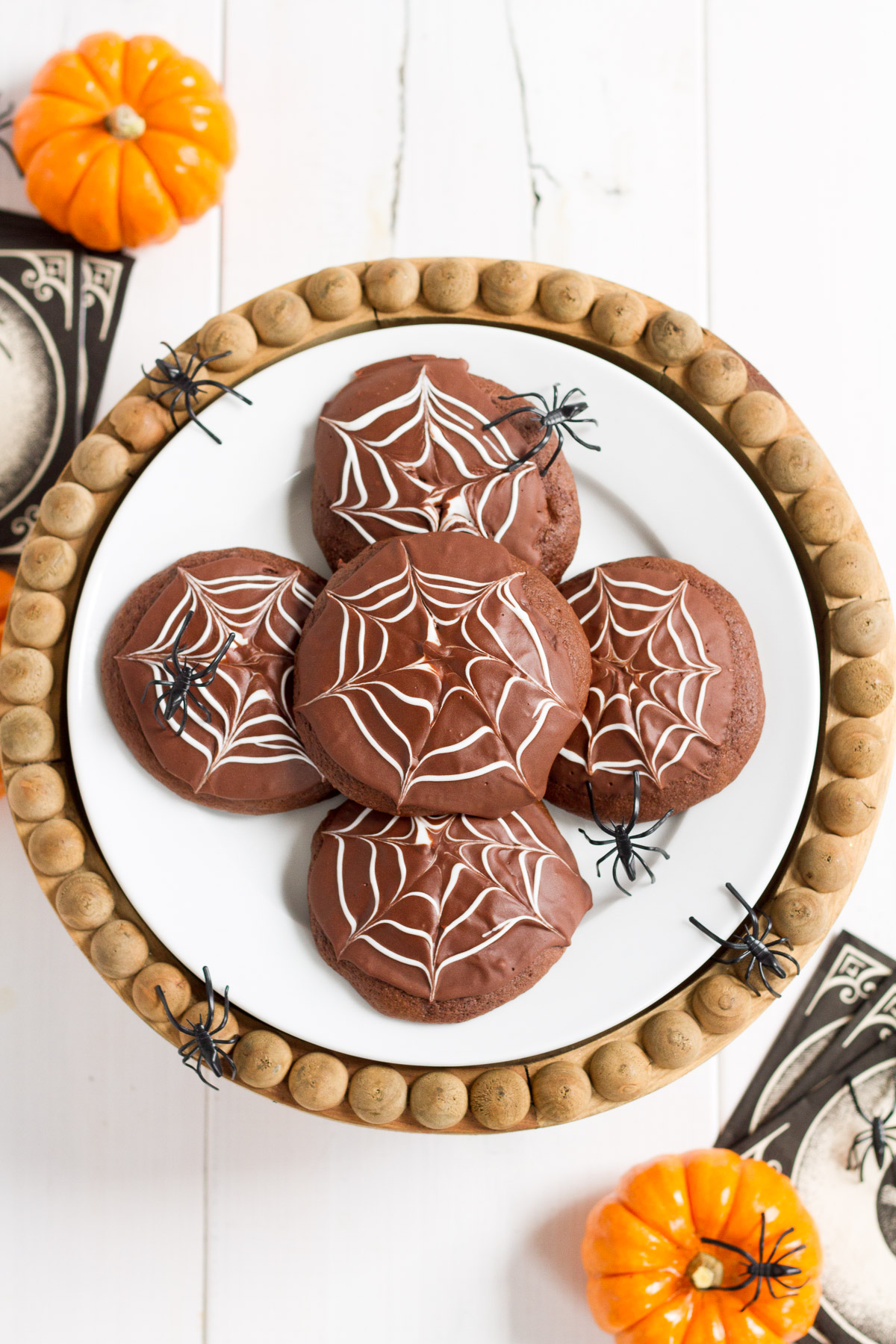Deliciously cakey chocolate cookies dipped in a rich, homemade chocolate glaze and decorated with white icing spider webs. Perfect for Halloween!