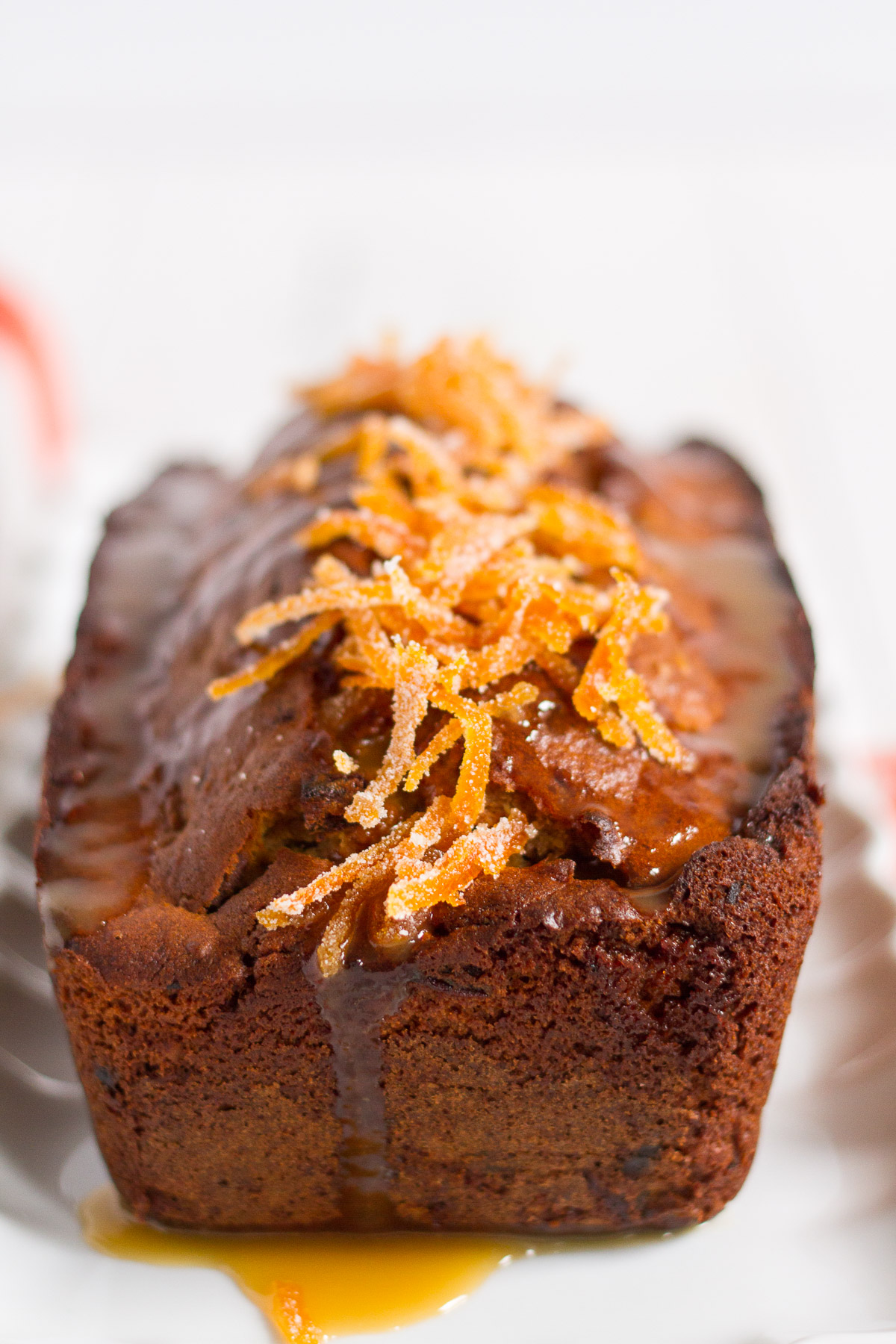 a delightful orange cake filled with dates and walnuts, and topped with a luxurious orange butterscotch sauce