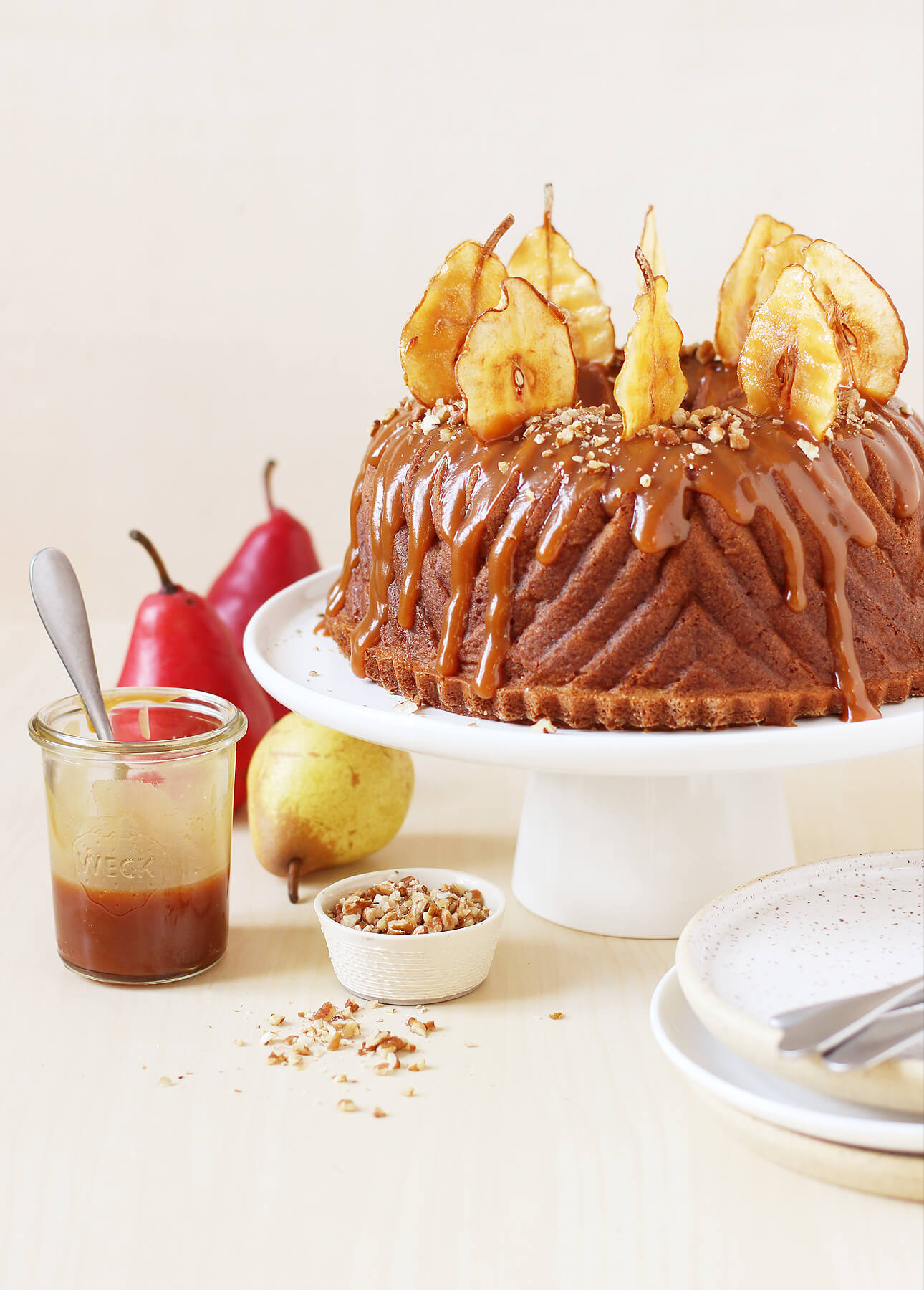 spiced pear bundt cake with salted caramel sauce and homemade pear crisps