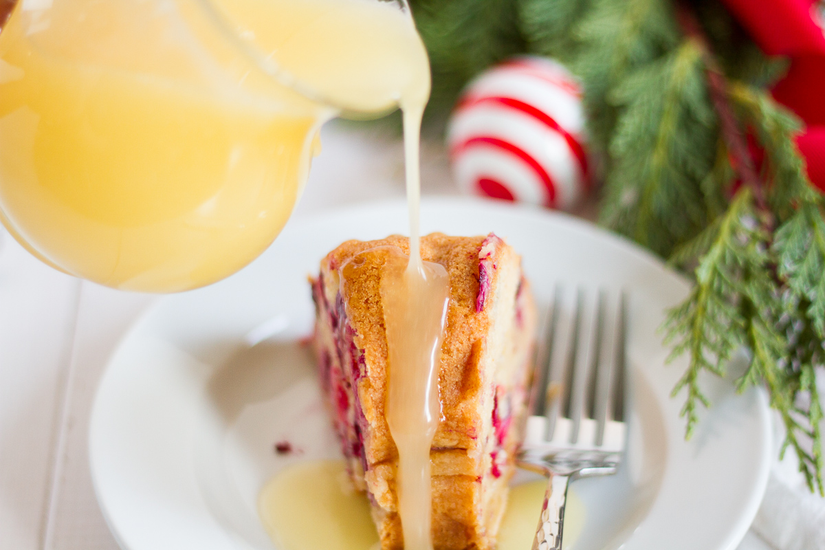 This fresh cranberry cake with hot butter sauce is simple and delicious. It is a breeze to make, but it looks beautiful and tastes luxurious. All of those things combine to make it the perfect dessert to serve to guests during the holidays.
