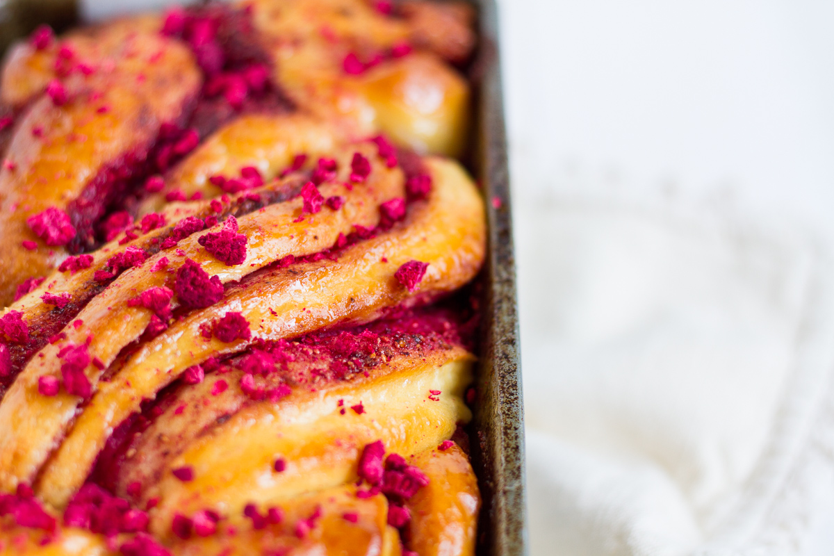 A classic brioche dough with raspberry swirled throughout, topped with a sticky sugar syrup and crushed, freeze-dried raspberries
