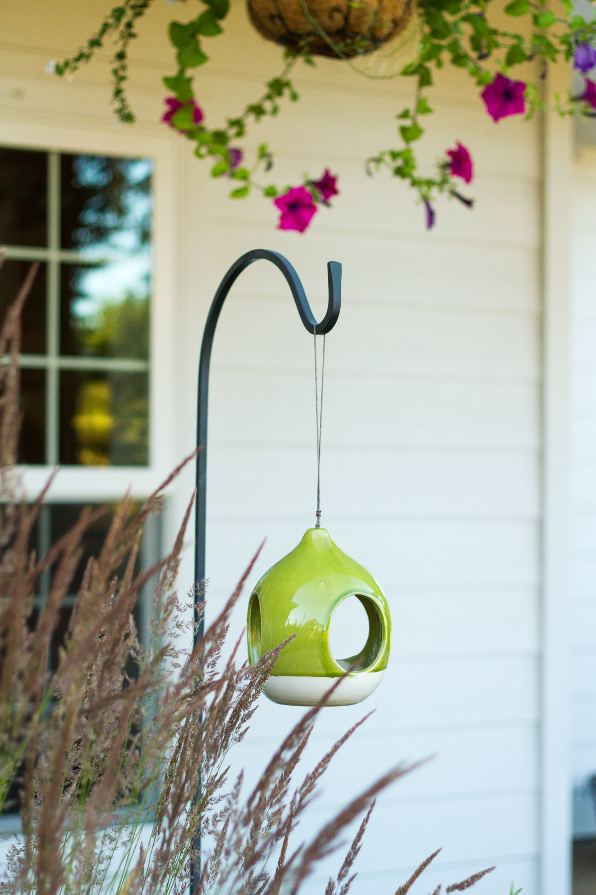 clay bird feeder in front yard landscape design