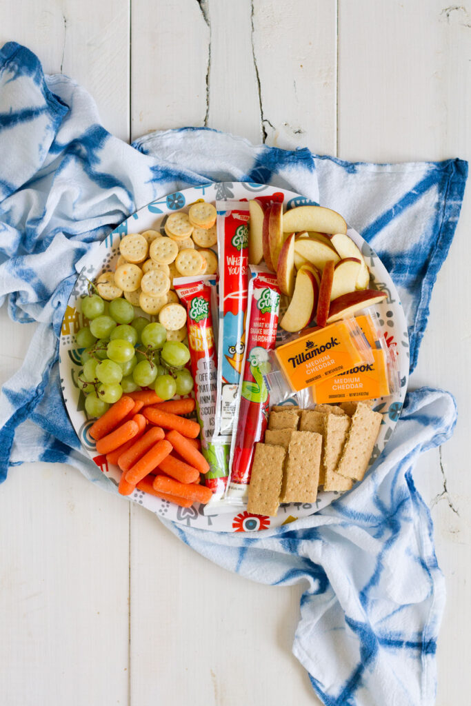 A snack tray loaded up with your favorite snacks makes a perfect summer lunch for the whole family.