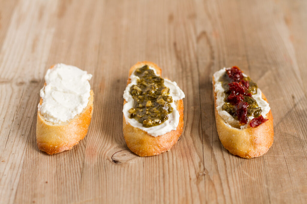 pesto and sun-dried tomato crostini are perfect for the holidays